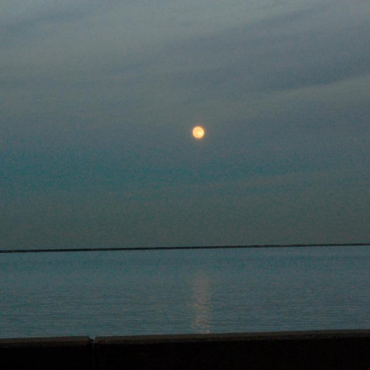 A bright moon over Lake Michigan