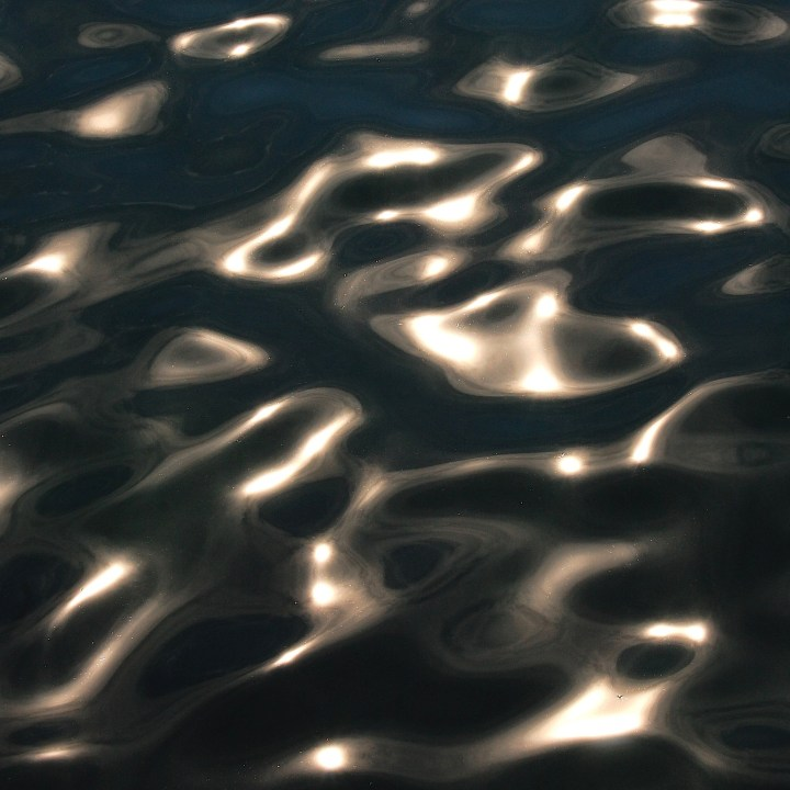 Sun glinting on water's surface