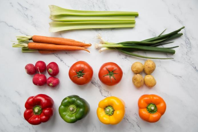 assortment of fresh and colorful vegetables on a marble countertop
