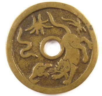 Old Chinese charm displaying five poisons
