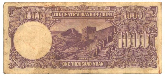 """Chinese paper money of """"1000 Yuan"""" (one thousand dollars) issued in 1942 by the Central Bank of China with an image of the Great Wall of China"""