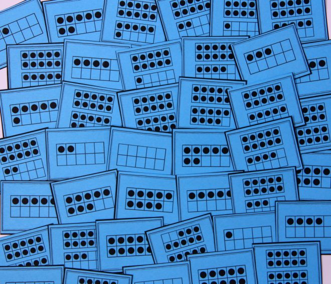 A collection of blue cards spread out across a table. Each card represents a number 0-20 on a ten frame or pair of ten frames while students build subitizing skills.