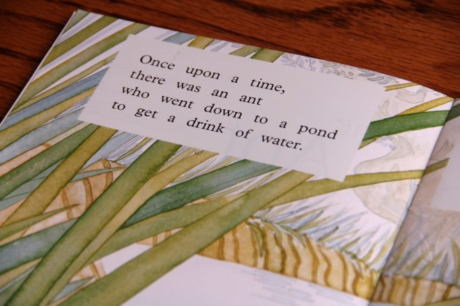 """Close up image of the text in a book. Text says """"Once upon a time,/ there was an ant/ who went down to a pond/ to get a drink of water."""""""