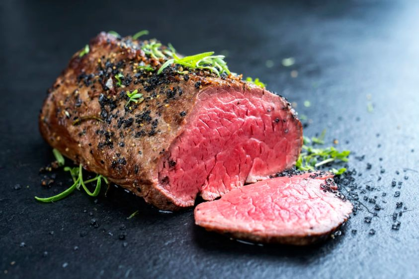 Traditional barbecue dry aged fillet steak with herb and spice marinated as closeup