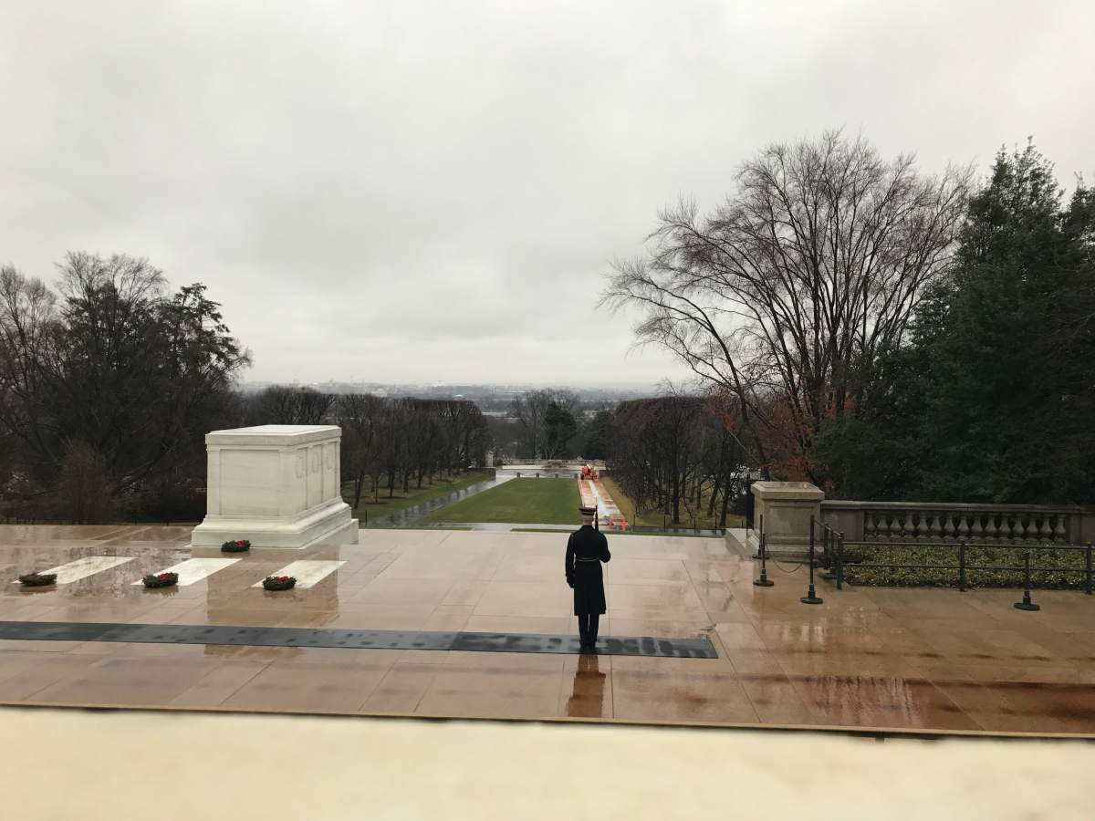 Soldier standing guard at the tomb of the unknown soldier at Arlington National Cemetery