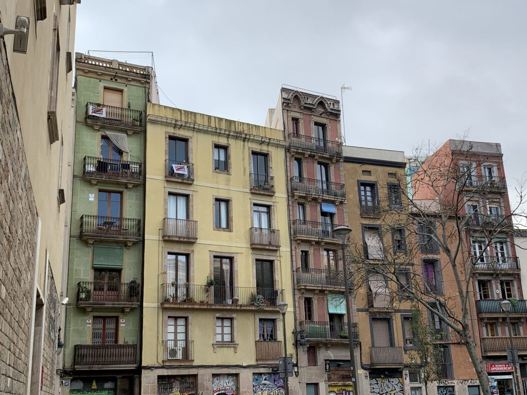 Old multicolored buildings side by side