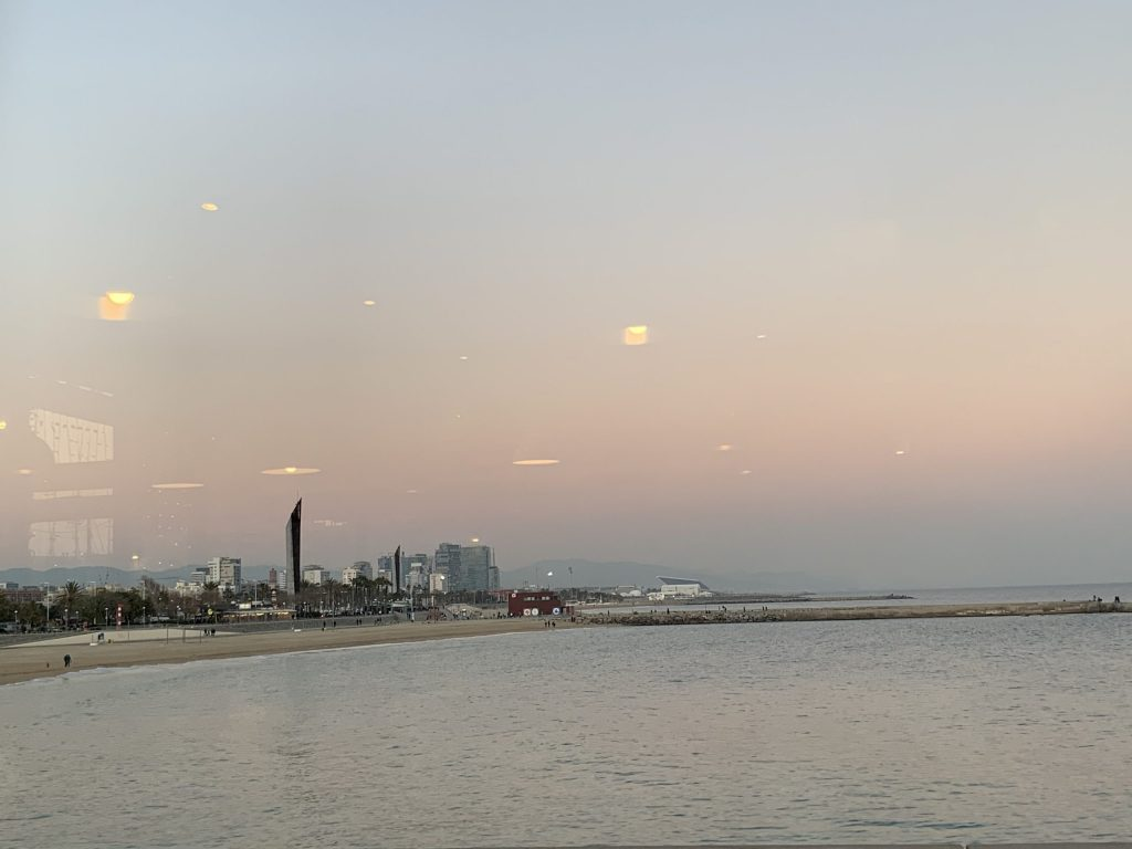 Barcelona skyline and beach shore from restaurant window