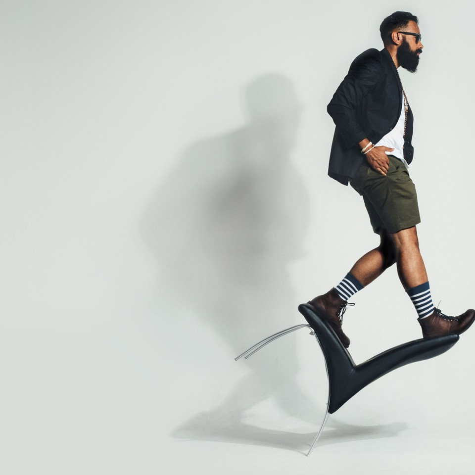 Man with a Beard Walking on a Chair