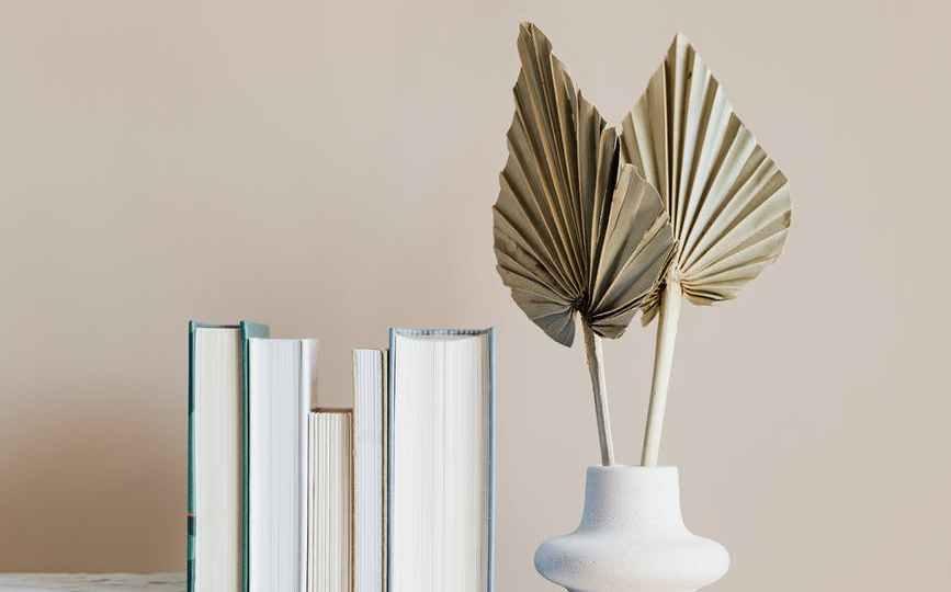 geometric marble shelf with books and decorative vase