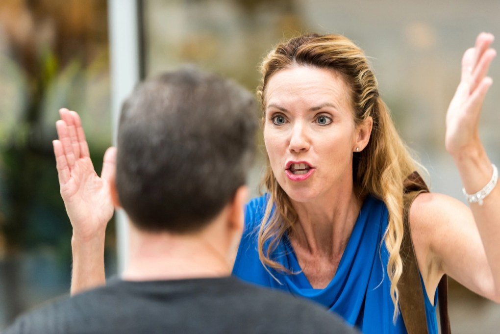 Woman yelling at man, couple arguing