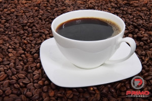 10641-a-cup-of-coffee-on-a-bean-background-pv