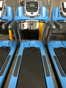 Custom powder blue frames on these treadmills