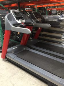 Custom red frames on these treadmills