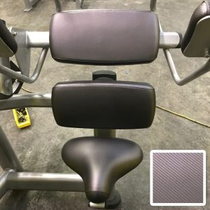 Custom upholstery: carbon fiber fabric on back extension machine
