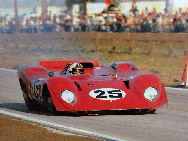 Enzo Ferrari framed by his 312P Ferrari 312P 1969