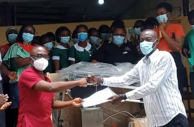 Mr-Buhari-right-making-the-presentation-to-Dr-Frimpong-620x406-1
