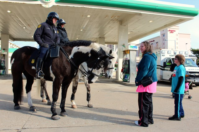 Members of the Virginia Beach Mounted Patrol are seen at work at the Oceanfront during the Shamrock race weekend in March 2015. Photo by John-Henry Doucette/Princess Anne Independent News