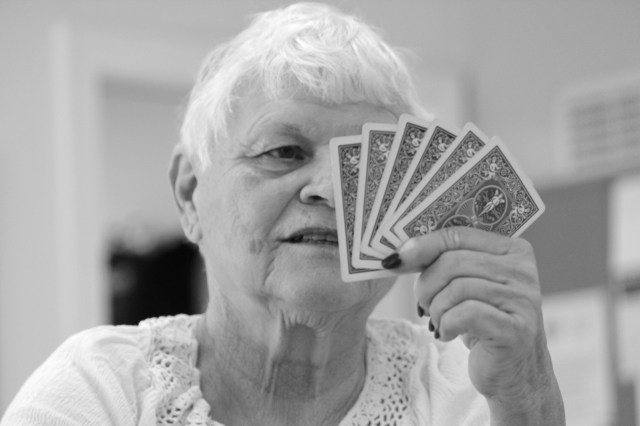 Julie Ogden considers her cards during the card game at the Senior Resource Center, Inc. [John-Henry Doucette/The Princess Anne Independent News]