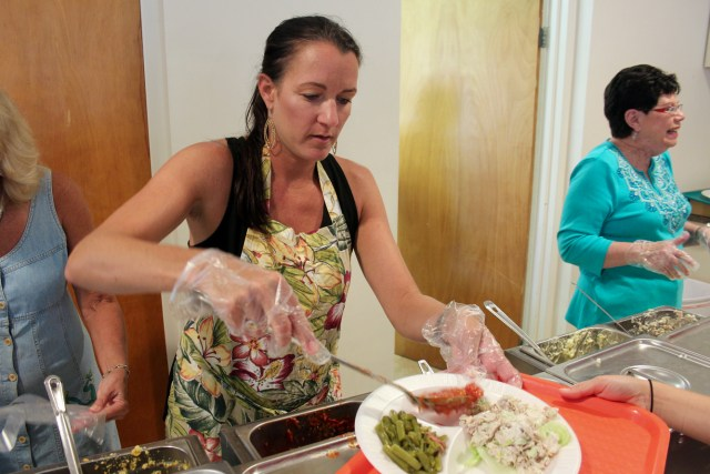 Laura Peters, 40, of Sigma, serves food during the luncheon that gathered members of the church and the surrounding community together at Tabernacle United Methodist Church. [John-Henry Doucette/The Princess Anne Independent News]
