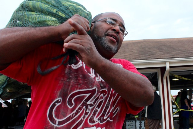 "it during the weekly produce auction at the Virginia Beach Farmers Market. They came, in part, because they wanted to change their eating habits. ""It's better than the store,"" Carrington said. [John-Henry Doucette/The Princess Anne Independent News]"