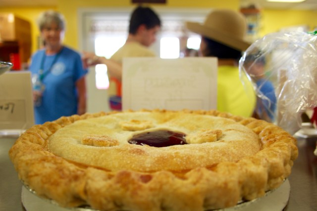 A strawberry pie rests on the counter, tempting customers of Seasons Best Bakery at the Virginia Beach Farmers Market. [John-Henry Doucette/The Princess Anne Independent News]
