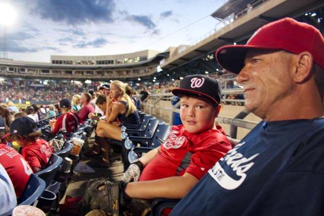 Herb Smith sits with his son, Hank, during the Tides game at Harbor Park in downtown Norfolk on Wednesday, July 22. [John-Henry Doucette/The Princess Anne Independent News]