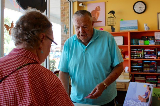 Bob Barnes assists a customer at the Strawbridge location of Barritt's Books. [John-Henry Doucette/The Princess Anne Independent News]