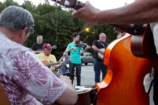 Fridays at the Virginia Beach Farmer's Market bring music to the stage through a concert series. On same night, musicians from Hampton Roads, North Carolina and beyond gather in the parking lot for an enduring bluegrass jam. [John-Henry Doucette/The Princess Anne Independent News]