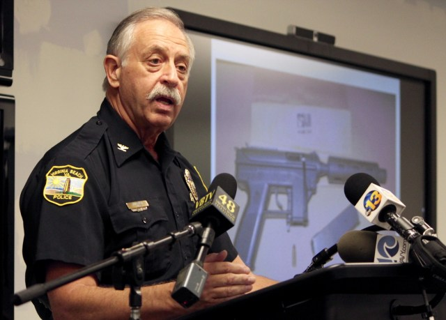 City police Chief Jim Cervera discusses an incident in which two people died after one of them opened fire upon police outside a convenience store at Salem and Lynnhaven Roads. The monitor behind him shows a weapon police said they recovered. [John-Henry Doucette/The Princess Anne Independent News]
