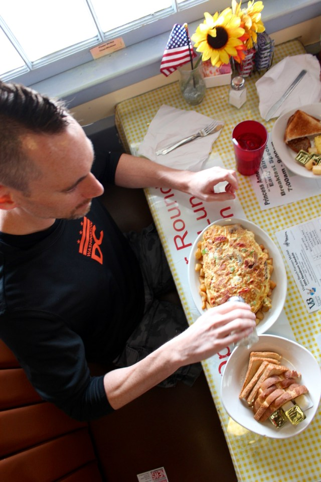 Scott Quirico of Northern Virginia, in town to run a race at the Oceanfront, fuels up with Eggzilla at Princess Anne County Grill. [John-Henry Doucette/The Princess Anne Independent News]