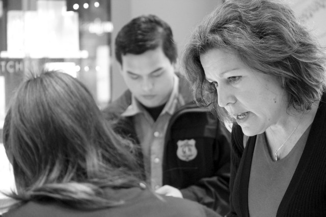 Master Police Officer Leta Krieger speaks with a merchant while Kevin Sarino, 17, takes notes. Sarino is a member of the Virginia Beach Explorers Post 911. [John-Henry Doucette/The Princess Anne Independent News]