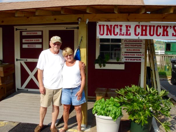 The Macins are seen together stading in front of the business at the Virginia Beach Farmers Market. [Courtesy]