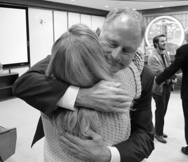 Dave Hansen gets a congratulatory hug following his selection as city manager in Virginia Beach. [John-Henry Doucette/The Princess Anne Independent News]