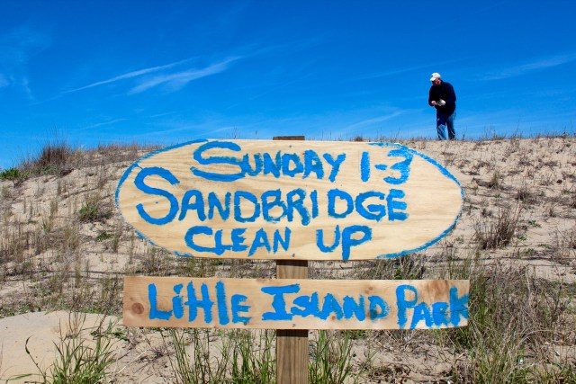 Sandbridge resident Wade Malaby hunts for garbage during the cleanup in Sandbridge on Sunday, April 9. [John-Henry Doucette/The Princess Anne Independent News