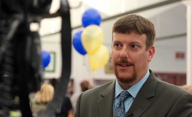 Dr. Alex Bergren, principal of Princess Anne Middle School, is interviewed on Tuesday, May 3, following a gathering to celebrate the school's recognition as a National School to Watch. He credited educators, parents, students and community partners. [John-Henry Doucette/The Princess Anne Independent News]