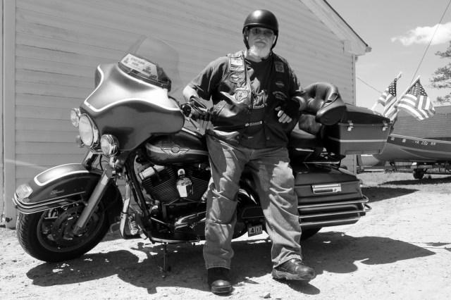 """Paul """"Bear"""" Angel is seen at West Neck Marina with his 2003 Electra Glide Classic Anniversary Edition, which he uses in rides to commemorate fallen members of the armed forces. [John-Henry Doucette/The Princess Anne Independent News]"""