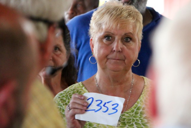 Sylvia Rose of Chesapeake, who said she comes to the auction every Wednesday, bids. [John-Henry Doucette/The Princess Anne Independent News]