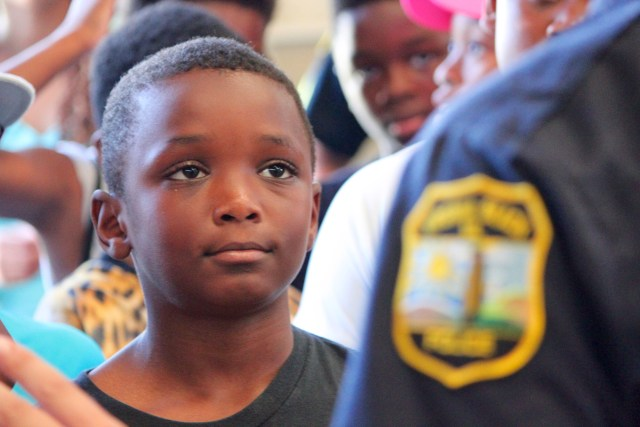 Norfolk's Charles Perkins, 10, was among the young people who interacted with the Virginia Beach Police Mounted Patrol Unit during a leadership development camp. [John-Henry Doucette/The Princess Anne Independent News]