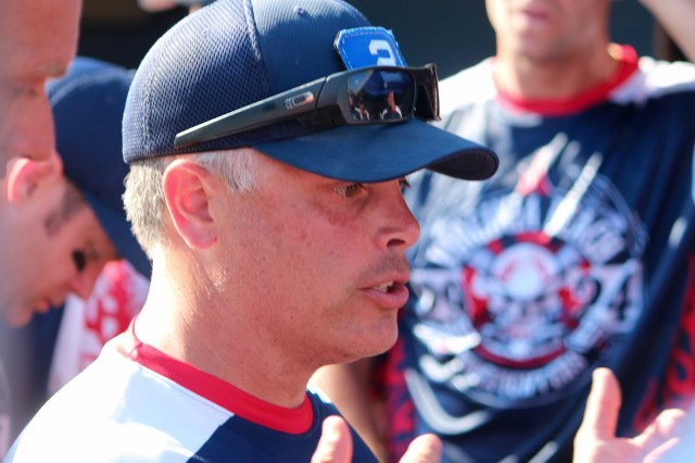 B.J. Raftery, who plays catcher and coaches for the Virginia Beach team, gives a pep talk. [John-Henry Doucette/The Princess Anne Independent News]