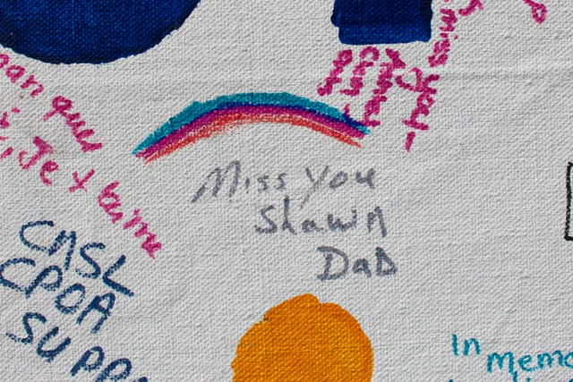 A detail of a banner showing messages to loved ones during the Out of the Darkness Community Walk at Mount Trashmore in 2016. [John-Henry Doucette/The Princess Anne Independent News]
