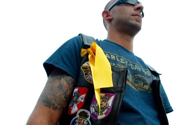 """Bruno """"Gypsy"""" DoAmoral of the Tidewater chapter of the V-Twin Cruisers Motorcycle Club wears a yellow ribbon to remember a friend, Nick Garza of Texas. [John-Henry Doucette/The Princess Anne Independent News]"""