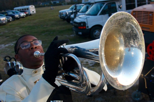 Damien Cason, 16, of Foxfire, seen playing his baritone, helps the band keeps the crowd motivated during Knights home games. [John-Henry Doucette/The Princess Anne Independent News]