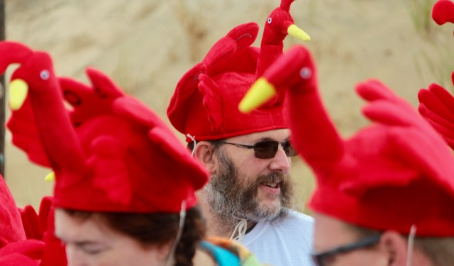 Rich Cassetta of Ashville, N.C., was among 17 loved ones, aged four to 77, to take part in the race while wearing turkey hats. All were visiting Sandbridge, and members of the family were from California, New Jersey and North Carolina. [John-Henry Doucette/The Princess Anne Independent News]