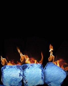 Burning ice cubes on black background