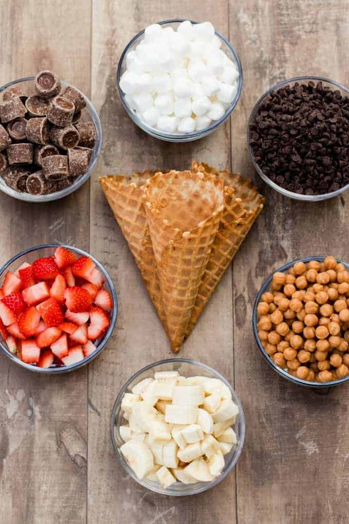 waffle cones, marshmallows, rolos, caramel chips, strawberries and chocolate chips