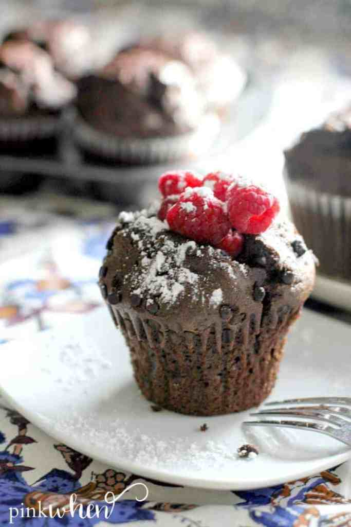 These chocolate raspberry breakfast muffins are super moist, easy to make, and ready in less than 30 minutes.