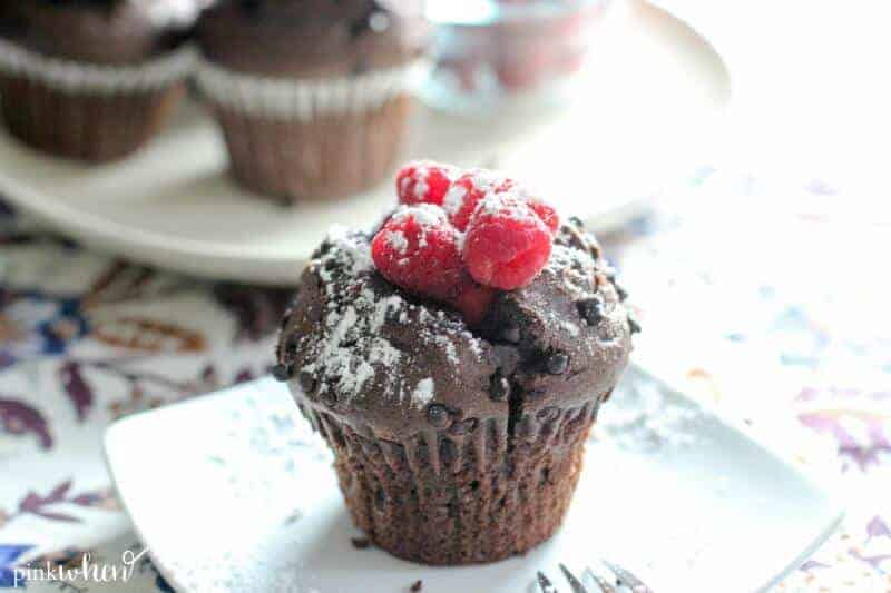 chocolate raspberry breakfast muffins with fresh raspberries and powdered sugar