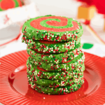 Christmas Pinwheel Cookies stacked on a red plate