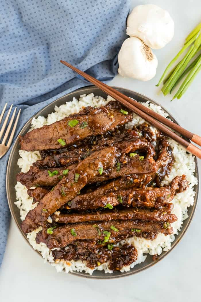 Mongolian Beef on a plate with chopsticks