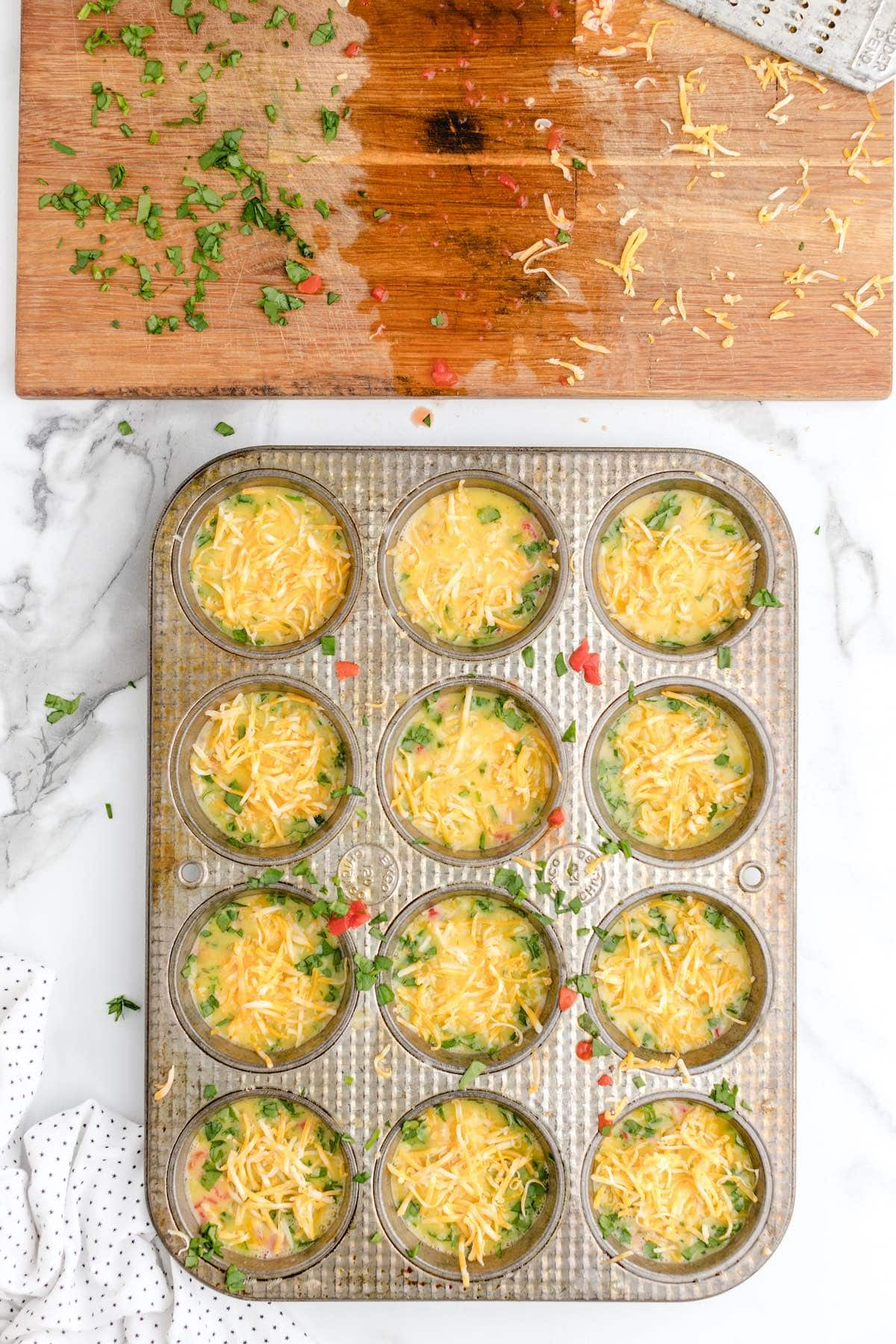 add cheese to each muffin stain
